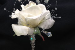 Prom-silk-069 $25 (plus tax and delivery) beautiful elegant white Rose boutonniere accented with sliver wire, silver ribbon, and clear gemstones.  Matches wrist corsage Prom-silk-062.