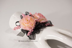 Prom-silk-070 $40 (plus tax and shipping) Custom peach colored Rose corsage accented with pink Lemonium and black shear ribbon.