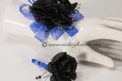 Prom-silk-071 $65 (plus tax and delivery) Black Roses wrist corsage and boutonniere set accented with nave blue shear ribbon and diamond jewels with diamond jewel band.