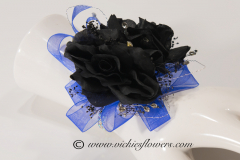 Prom-silk-072 $45 (plus tax and delivery) Black Rose wrist corsage accented with shear blue ribbon, diamond gems, silver wire, and jeweled wrist band.