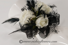 Prom-silk-075 $45 (plus tax and delivery)  Gorgeous silk black and white wrist corsage  with white Roses, accented with black feathers, black gemstones, and black shear ribbon on a black band.
