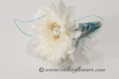 Prom-silk-079 $20 (plus tax and delivery) White and blue/green turquoise boutonniere accented with blue green wire, studded with gemstones and pearl..